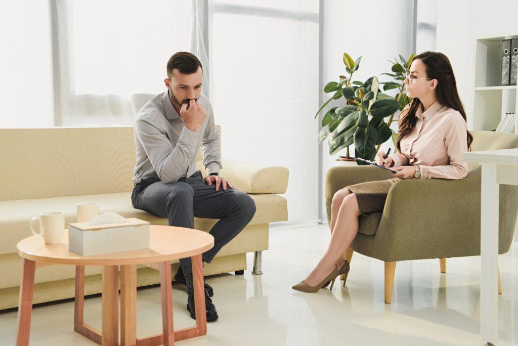 Psychiatrist and sad patient