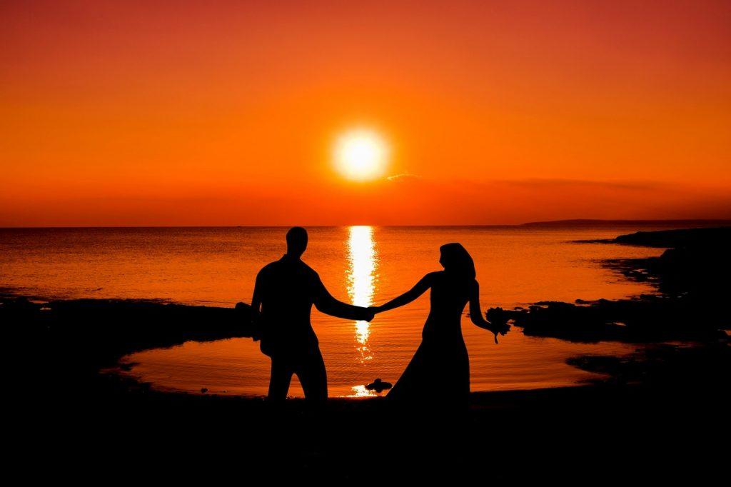 couples enjoying sunset