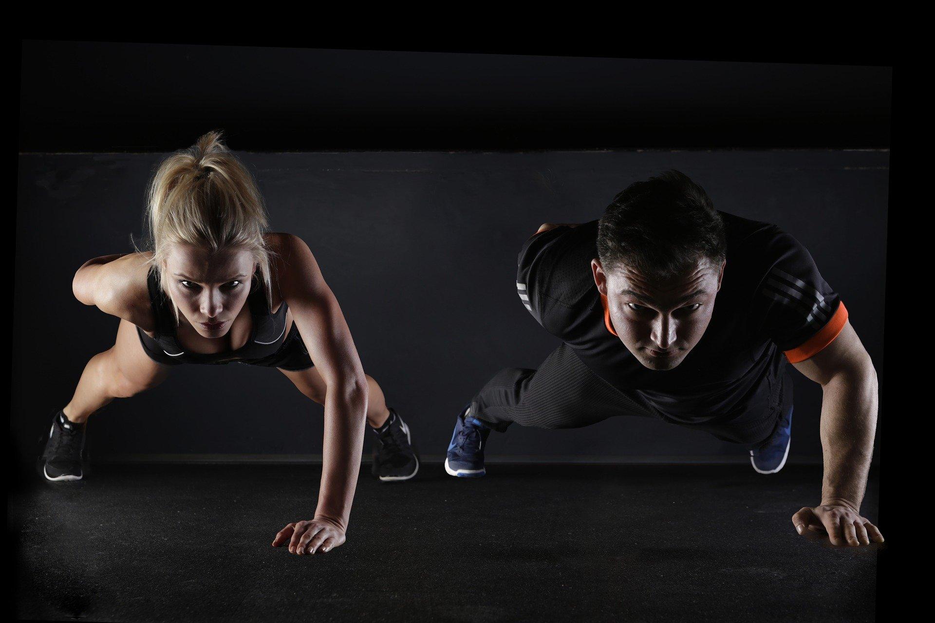 Man and woman doing push-ups